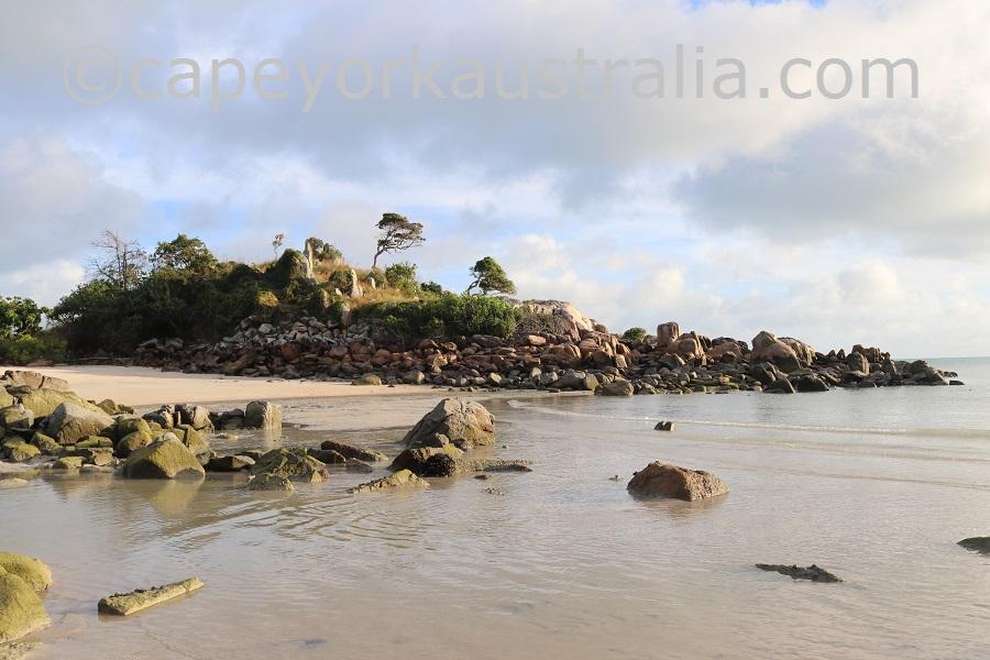 badu island beach rocks