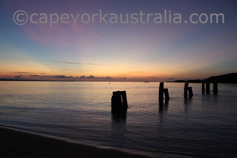 seisia sunset old jetty poles